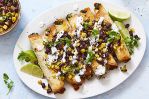 For this Broccoli-Cheddar Taquitos with Crema & Corn Black Bean Salsa, we fill flour tortillas with finely chopped broccoli and cheddar, roll tightly, and bake until crisp and then serve crunchy taquitos with homemade corn-black bean salsa, sour cream, fresh cilantro, and lime for squeezing over.