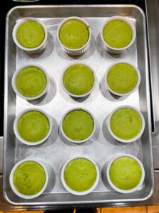 These ramekins are filled with individual pea flans - the silky texture of this custard is an elegant way to show off the subtle flavor of peas.