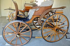 This carriage is a Brewster Wicker Phaeton. Also known as a Lady's Wicker Phaeton, the low-slung body allowed easy access for women wearing long skirts.