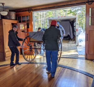 And here is the gig carriage coming in. On the floor of this Carriage House is a turntable designed by Jens Jensen. It was intended to allow Edsel Ford's carriages to be turned 360-degrees so the wheels always faced forward when taken out for a ride - it is still in perfect working condition today.