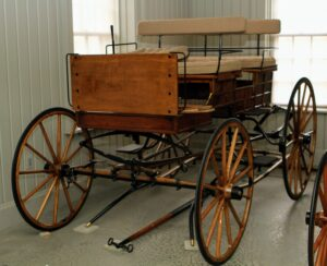 """Here is another carriage - a Brewster Bronson Wagon from 1900, which was the popular sporting wagon for country gentlemen. It's framed and paneled sides were the inspiration for the early """"Woody"""" station wagons."""