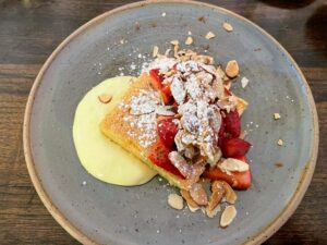 And for dessert - olive oil cake with lemon curd, strawberries, and white chocolate almonds.