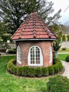 "This is a garden folly that was built in the ""Sunken Garden"" in the late 1800s. A garden folly is usually considered a building or structure designed for decoration with no other purpose than to add a touch of whimsy or extravagance to the surrounding landscape."