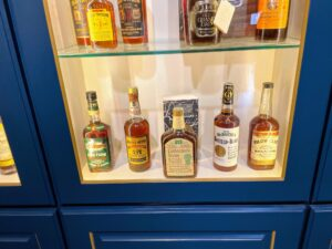 Rare finds from the 50s and 60s such as this Collector's Item 20 Year on the bottom shelf would be the centerpiece in any whiskey collection.