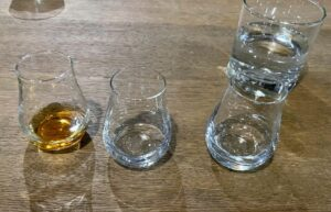 Tulip-shaped glasses like these wee drams help funnel the scent of the bourbon to the nose.