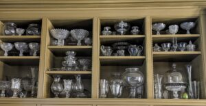 Along one wall of my Brown Room, I have deep shelves filled with precious glass and crystal. Every so often it is a good idea to take stock in these pieces and clean them so they're ready for the next special occasion or holiday.