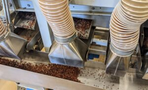 The separated pieces fall through the vacuum system's tubes and down a stainless steel ramp.