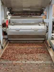 At Mast, the cocoa beans are first inspected by hand and then lightly roasted in small batches before being put through a winnower. This machine essentially removes the outer shell from the cocoa beans.