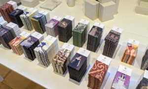 On another table, a range of 12 organic, ethically sourced, and handcrafted chocolates featuring artwork from The Metropolitan Museum of Art in New York City. These chocolates were made in support of the Museum's 150th anniversary.