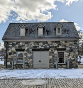 This is my Carriage House at the farm. It is located next to my large stable and across from another structure used for staff offices. This Carriage House houses several carriages and a sleigh downstairs. The upstairs is a guest apartment.