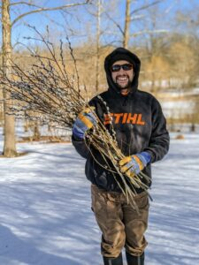 Brian takes the last bunch of pussy willows up to the greenhouse for trimming.