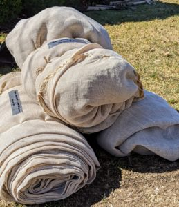 Here is a pile of burlap covers properly tied and labeled for storage. My crew has been doing this for years – they have streamlined the process.