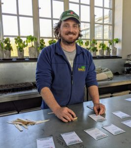 Once they are all organized, Ryan determines what order they will be started in the trays depending on how long it takes each plant to germinate. Starting from seed and nurturing them as they grow is among Ryan's favorite gardening jobs.