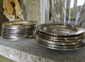 Whenever I decorate with plants, I use silver or glass plates, purchased from tag sales or antiques fairs, under the pots to catch any water. Ryan took out a stack of these silver plates to use.