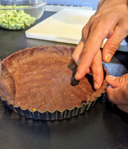 Our other planned dessert is my Milk Chocolate-Pistachio Tart, also available on my web site or by clicking on this highlighted link. Here, Chef Pierre prepares the chocolate crust.