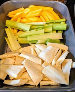 All the vegetables are cut into smaller pieces - here are the carrots, celery and parsnips. I love serving lots of root vegetables with my corned beef.
