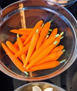 Here is a bowl of beautiful bold orange carrots.