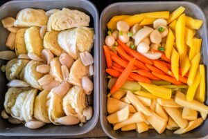 Once they are boiled, the vegetables are put aside in large pans. These vegetables will be warmed before serving.