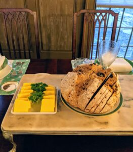 Traditional Irish soda bread loaves were placed on serving boards, so guests could help themselves. Pats of Kerry Gold Irish butter were served on the side - one row of salted, and one row of unsalted.