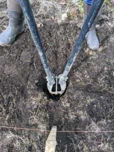 Next, post holes are dug deep into the ground – and all dug by hand.