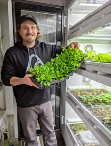 And here's Ryan at the big Urban Cultivator taking out another tray of seedlings ready to be repotted. We'll be very prepared for the growing season this year - I am so excited.