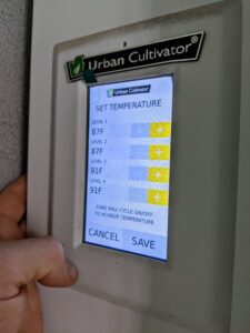 Here is the temperature panel. The Urban Cultivator is pre-programmed for an average growing situation, but it can also be customized to fit various environments.