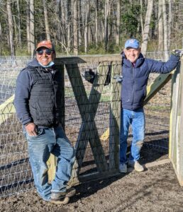 And here are Pete and Fernando in front of the pumpkin patch gate - repurposed from an older fence around the vegetable garden. Great job, guys. Now it's time to get out that rototiller!