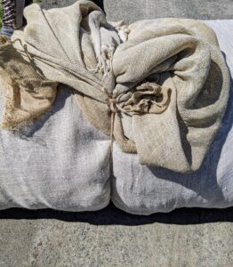 Domi then ties the sections of burlap with jute twine – we use this natural twine for many projects at the farm.