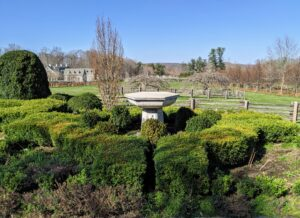 And here is the lower parterre showing the boxwood hedge around one of two antique fountains with the stable and green paddocks in the distance. What a gorgeous time of year.