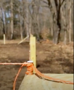 Mason string is secured atop all the posts to ensure everything is positioned in a straight line.