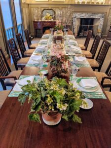 Whenever I entertain, I love to set a gorgeous table in my Brown Room. My housekeeper, Enma, works with me to choose the place settings. Of course for this occasion, we used a green theme for St. Patrick's Day. Three blooming begonias were used for the centerpieces.