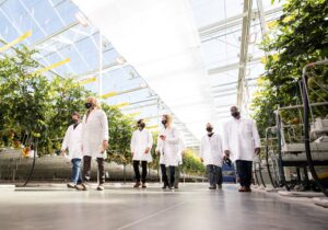 Once inside, we all put on white lab coats before the tour. (Photo courtesy AppHarvest)