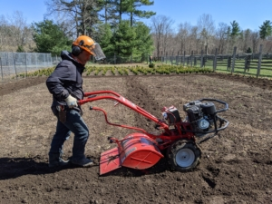 Phurba uses our Troy-Bilt Pony Rear-Tine Tiller to go over the two vegetable gardens a total of three times each. Thorough tilling over time can improve soil structure.