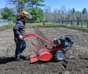 The machine needs a lot of control to maneuver it through the soil, so Phurba goes slowly to make sure every bit of the soil is turned.