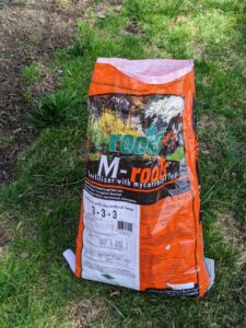 """I always say, """"if you eat, so should your plants."""" For all of these plants, we're using M-Roots fertilizer with mycorrhizal fungi, which helps transplant survival and increases water and nutrient absorption."""
