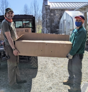 It's always exciting when trees arrive at the farm. Since I plant so many trees, I get most of them in the form of bare-root cuttings. Brian and Chhiring load one of two big boxes onto our trusted Polaris Ranger.