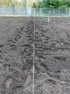 Now it's time to plan all the beds for planting. I try different configurations every year to see which ones work best for what we are growing. I like to use the most amount of space possible for planting. Here is a line of jute twine marking the center of the garden.