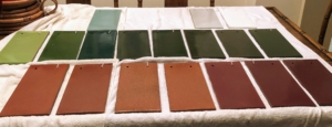 Here is a closer look at the collection of sample tiles. Ludowici clay tiles come in an array of colors. Since 1888, architects, designers, homeowners, commercial, and government clients have used Ludowici. Some of the company's other projects include The Plaza Hotel in New York City, the Broadmoor Hotel in Colorado, Hotel Hershey in Pennsylvania, Disney in Shanghai, and even the White House. In the end, Lisbeth chose a color combination of the two left tiles in the bottom row - a gold red cedar color.