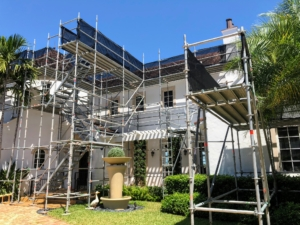 Meanwhile, at the house, scaffolding was placed around the perimeter of the home. This process took a few weeks to complete.