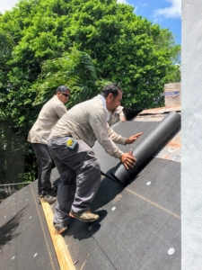 After all the old tiles are removed, a 30-pound felt is used to cover the roof. This felt protects the roof from wind driven rain under the shingles.