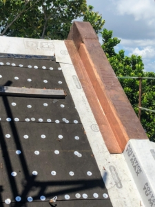 Next, skilled craftsmen install the hand-hammered and hand-soldered copper metal flashing where needed.