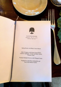 The menus are typed on white paper and inserted into a card stock booklet.