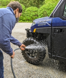 Next, he hoses down the entire body. These massive wheels are built for off-road terrain in all kinds of conditions, so we can drive this vehicle through all areas of the farm where a car cannot go.