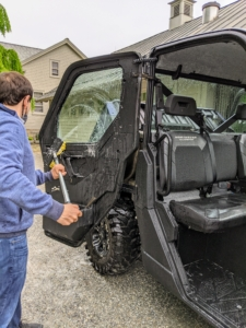 He soaps the doors inside and out. This model Polaris is also equipped with heating and air conditioning and power windows.