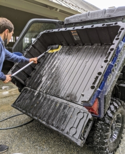 Andres tips the cargo box back and soaps it down. The cargo box is quite large, and has a hauling capability of 1000 pounds.