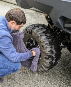 Lastly, Andres wipes down the 29 inch tires, which provide excellent traction and strength.