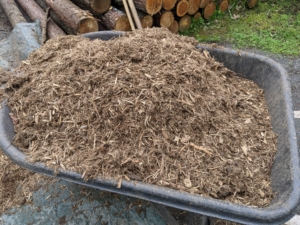 Mulch refers to a layer of some type of material on the surface of the soil. It is usually coarse in texture and makes the bed look well manicured, while helping to keep the soil cooler in summer. This is different from compost, which is used as a soil amendment.