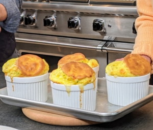 Here are the souffles. A soufflé is a baked egg-based dish originating in France in the early 18th century. Combined with various other ingredients it can be served as a savory main dish or sweetened as a dessert. And be sure to always serve them right away before they deflate.