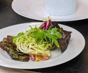 And here's our salad. Use a mix of greens such as radicchio, chicory, endive, and red leaf Boston lettuce.