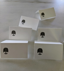 We also prepare place cards for the dining table. I write each guest's name on a card and place them by each guest's place setting shortly before everyone arrives.